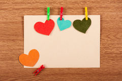 Card with hearts on wooden background Stock Photos
