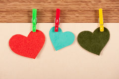 Card with hearts on wooden background Stock Images