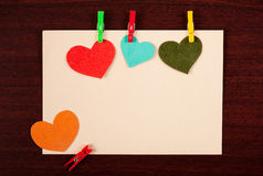 Card with hearts on wooden background Royalty Free Stock Photography