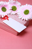 Card for a holiday. Beautiful celebratory card with colours and a gift Royalty Free Stock Photo
