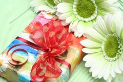 Card for a holiday. Beautiful celebratory card with colours and a gift Stock Image