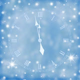 Card for the holiday with clock. On the blue background Royalty Free Stock Photos