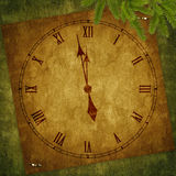 Card for the holiday with clock. On the abstract background Stock Photography