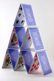 Card House. Vertical Closeup of a card house (or card tower) built with playing cards, in white background stock image