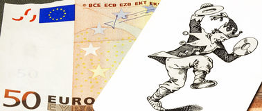 Card with the image of the joker is on the fifty euro banknote. Some cards with the image of the joker is on a part of fifty euro banknotes Stock Images