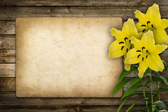 Card for invitation or congratulation with yellow lily flower Stock Photos