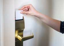 Card key door lock. Hotel room electronic door locked. Hand opening it with card key Stock Images