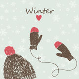 Card with knitted cap and mittens Royalty Free Stock Image