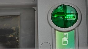 Card light flashing on ATM machine Stock Images