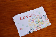 Card with Love for Valentine's day. With confetti Royalty Free Stock Photography