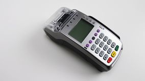 Card machine for paying with credit card. Pos terminal - modern technology for shopping and banking. White background. Royalty Free Stock Images