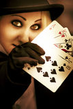 Card Magician. A Woman Card Magician Show Her Hand Of Playing Cards While Keeping A Poker Face In A Magic Card Trick Performance Royalty Free Stock Photo