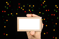 Card with many-colored sparkles on hand. Stock Photography