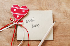 Card with Message With Love in the Letter and wooden red heart o Stock Photo