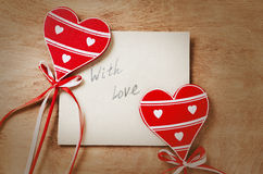 Card with Message With Love in the Letter and wooden red hearts Royalty Free Stock Images
