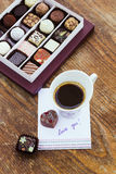 Card with message Love You, cup of coffee  and chocolate candies Royalty Free Stock Photography