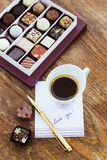 Card with message Love You, cup of coffee  and chocolate candies Royalty Free Stock Images
