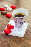 Card with Message Love You, cup of coffee and chocolate candy Royalty Free Stock Photo