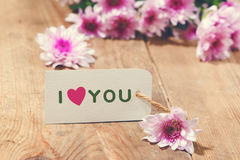 Card with Message Love You on the Letter on wooden background Royalty Free Stock Image