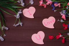 Card with Message Love You on the Letter on wooden background Stock Photos