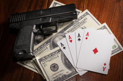 Card with money and gun. Royalty Free Stock Photo