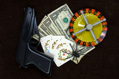 Card with money. gun and roulette.  Royalty Free Stock Photos