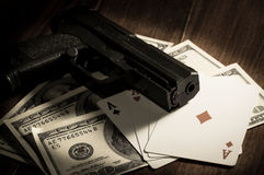 Card with money and gun. Stock Photography