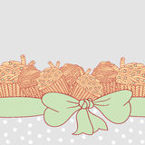Card with muffins tied with ribbon and bow Royalty Free Stock Image