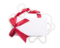 Card note with red ribbon on white background Royalty Free Stock Image
