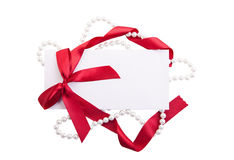 Card note with red ribbon on white background Royalty Free Stock Photos