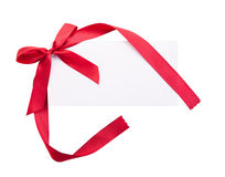 Card note with red ribbon on white background Stock Photos