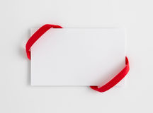 Card notes with red ribbons. On background Stock Image