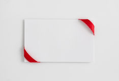 Card notes with red ribbons Royalty Free Stock Photos