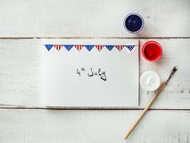 Card with a pattern of the US Flag. Handwritten inscription with congratulations on July 4th on a white, vintage, wooden table. Top view, close-up. Concept of vector illustration