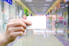 Card payment in hand. Payment card in hand on the background of the store Stock Images
