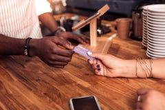 Nice afro American man taking a debit card royalty free stock photos