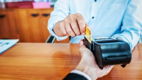 Card payments between businessmen via credit card machine in the office. Banking concept royalty free stock photos