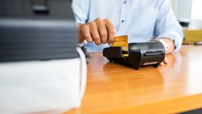 Card payments between businessmen via credit card machine in the office. Banking concept stock images