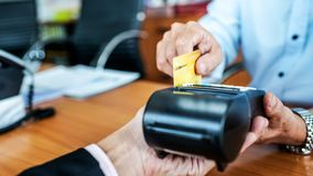 Card payments between businessmen via credit card machine in the office. Banking concept royalty free stock photo