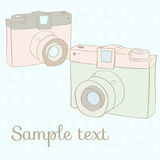 Card with Photo Cameras. Vector vintage photo cameras on polka dot background Stock Photo