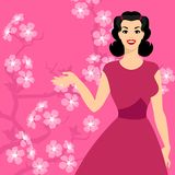 Card with pin up girl and stylized cherry blossom Royalty Free Stock Image