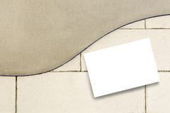 Card on plaster cement wall Stock Image