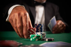 Card player gambling casino chips. On green felt background selective focus stock photo