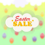 Card, poster, banner for festive Easter sales. Text on a voluminous cloud on a blurred background of the sky with falling Easter eggs Royalty Free Stock Photography