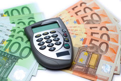 Card reader with money. Bank card reader, internet banking authorization device lying on some euro bills Stock Photo