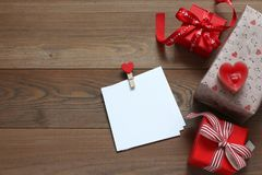Card for recognitions and romantic gifts on a wooden table Stock Images
