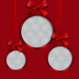 Card. Red balls with bows and place for an inscription on a red background. Hanging on the tapes. Christmas tree toy Stock Image