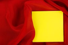 Card on red colored satin cloth. royalty free stock photos