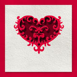 Card with a red heart made of paper on a white background Royalty Free Stock Photography