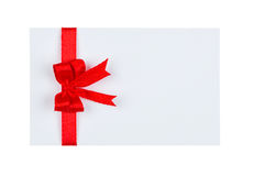Card with red ribbon bow on white background Stock Photos